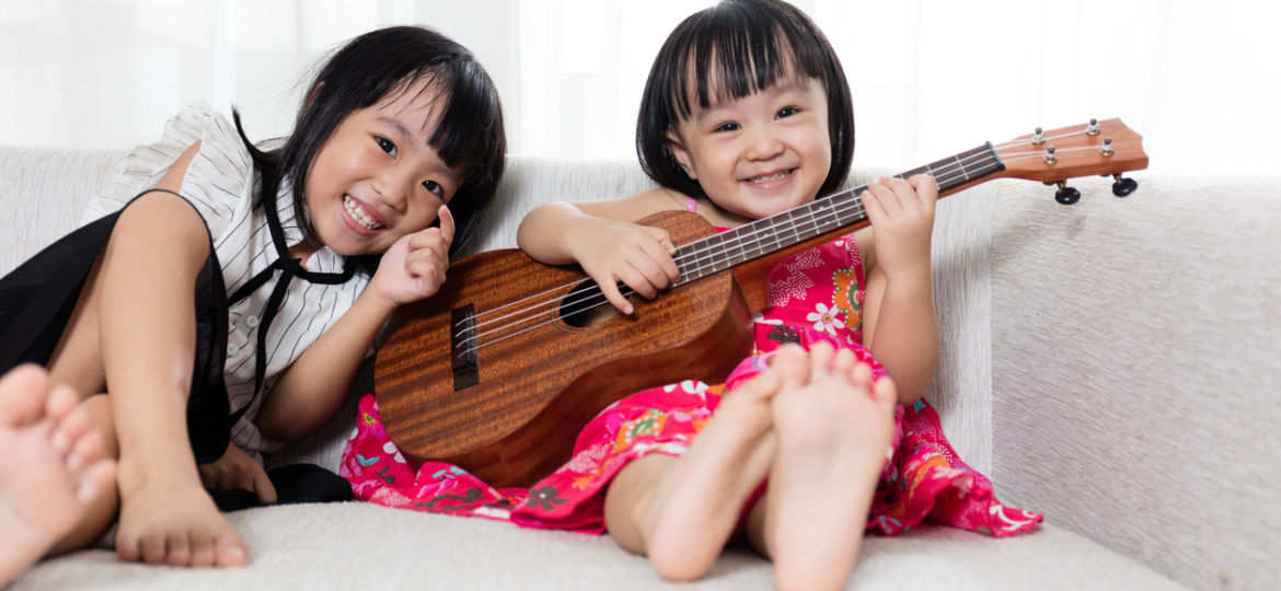 Asian Chinese little sister playing ukele